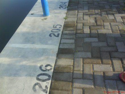 pemberian nomor untuk pembagian tempat pemancing saat lomba mancing di Embung Merdeka